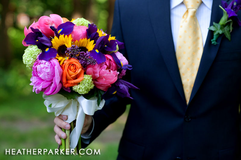 navy blue tuxedo coordinating with bridal bouquet colors
