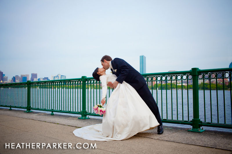 Boston wedding photographer Heather Parker photographs a bride and groom at the Boston skyline