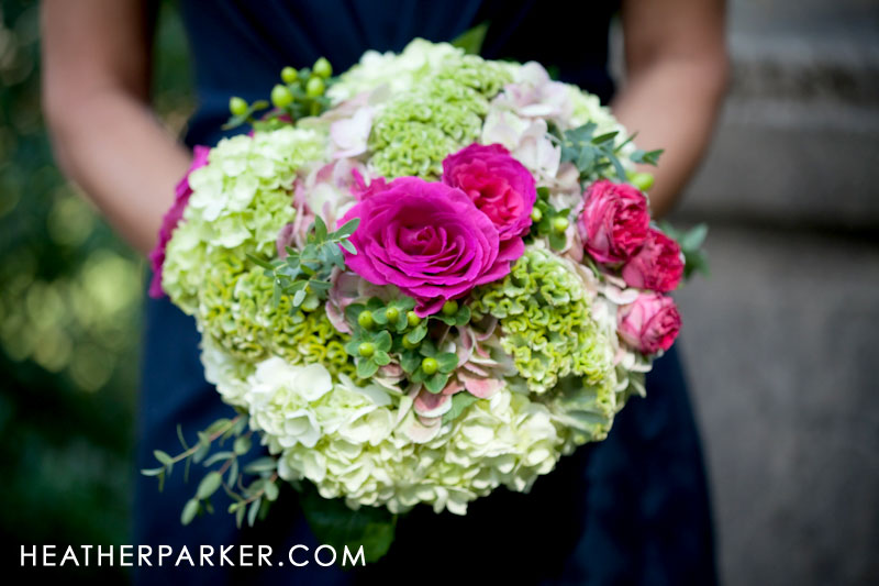 hot pink wedding bouquet with green and navy