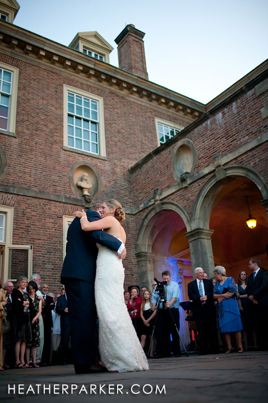 first dance on an outdoor patio at a mansion