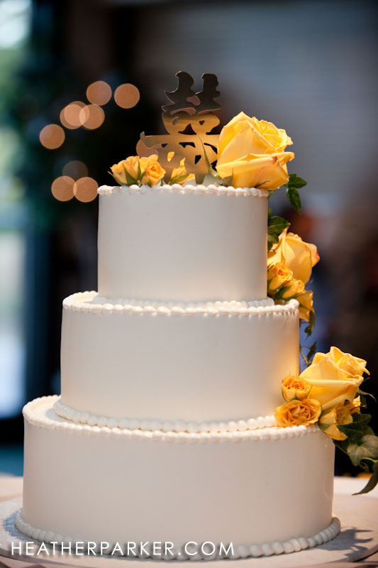 white wedding cake with yellow details