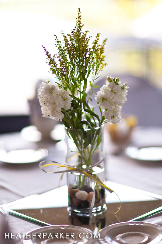 floral centerpiece at a wedding that used yellow for their colors