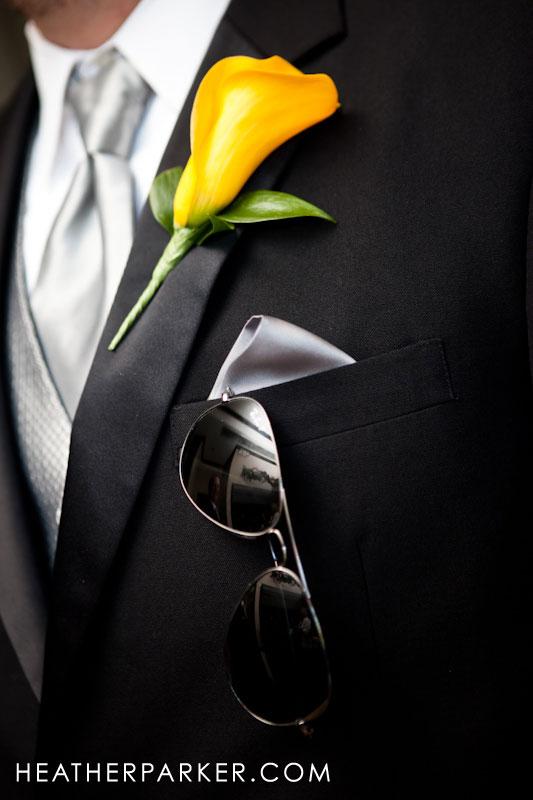 yellow boutonniere on groomsman