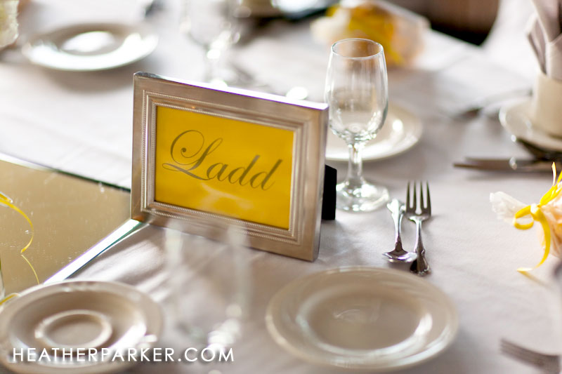 frames with yellow table numbers for wedding decorations