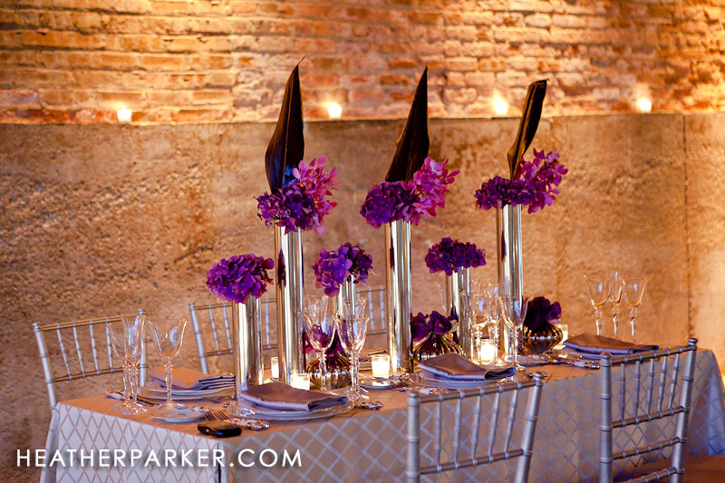 is using a rectangular reception table purple fushia wedding decor by
