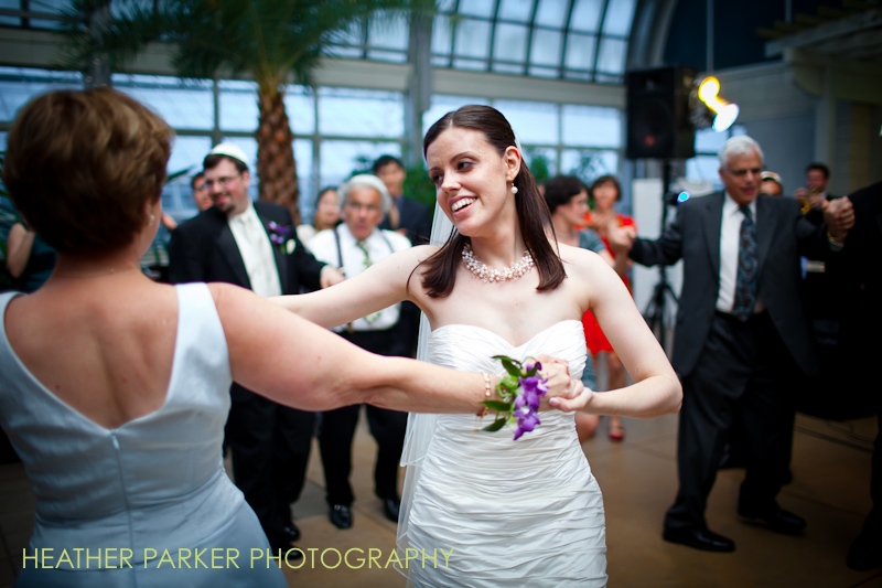 garfield park conservatory for a wedding reception with photos of a jewish hora