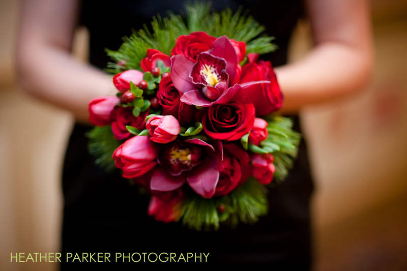 black bridesmaid dress with red bouquet for christmas wedding