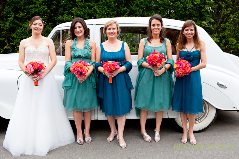 nantucket wedding gown and bridesmaid dresses ivory navy teal blue in front of antique car rental