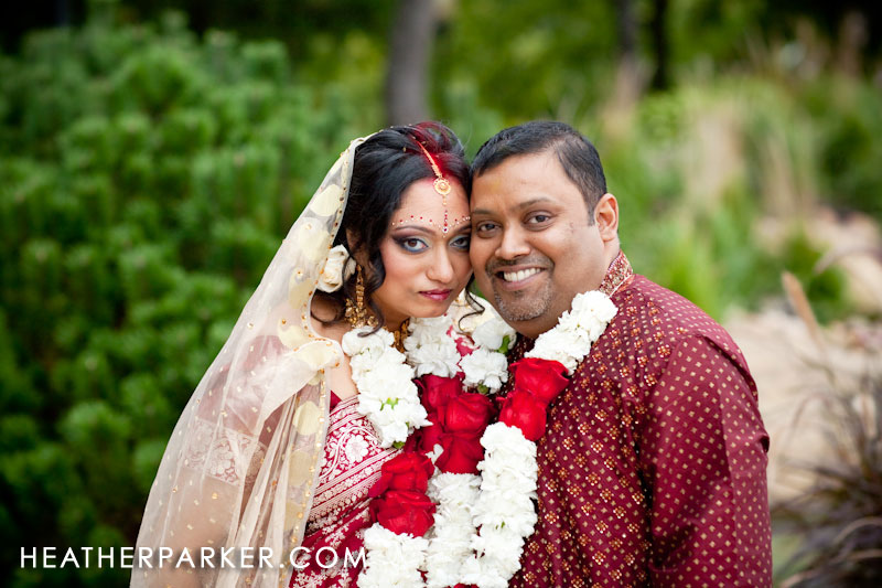 bride and groom pictured with sari on their wedding day