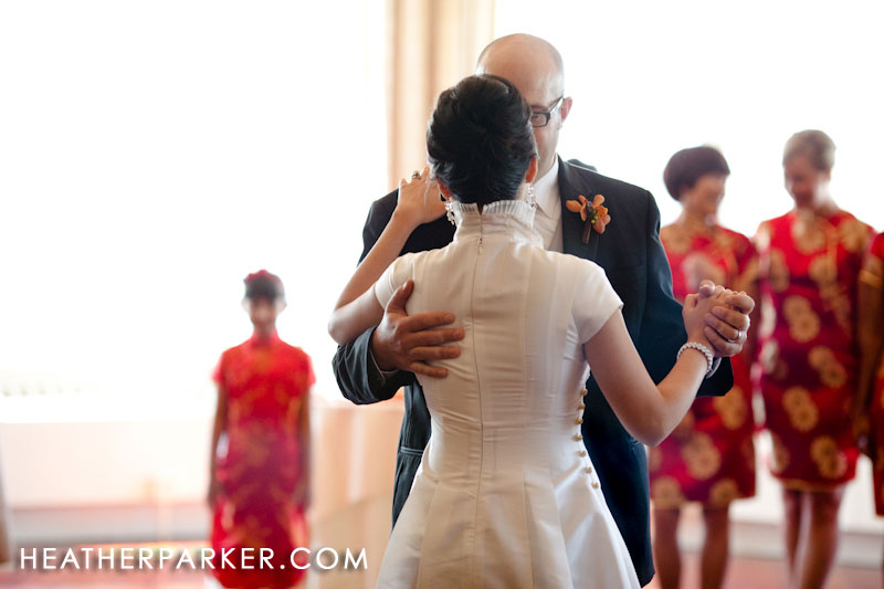 wedding qipao bridesmaid in the background during first dance