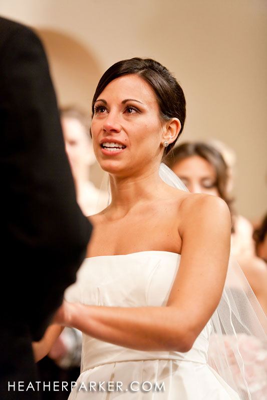 a boston bride crying with emotion at her greek wedding ceremony